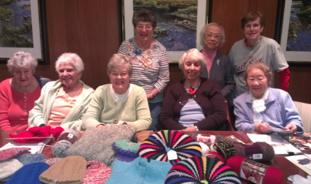 Fuller Village residents with handmade crafts